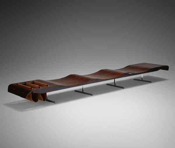 MCM Daily oOnda bench designed by Jorge Zalszupin. Made from rosewood and steel, with leather magaz…