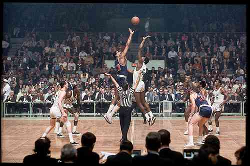 Tip off- Wilt Chamberlain and Bill Russell.