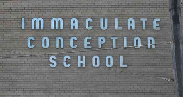Signage on the front of Immaculate Conception School (1950). Photograph by Paul Shaw (2016).